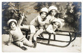 Old photo of kids with sledge. vintage christmas postcard — Stock Photo