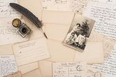 Old letters, vintage postcards and antique feather pen — Zdjęcie stockowe