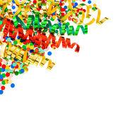 Confetti assorti avec des banderoles colorées brillant sur blanc — Photo