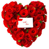 Red heart of roses with white card for your text — Stock Photo
