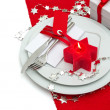 Christmas table place setting decoration in red and silver — Stock Photo