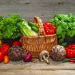 Fresh vegetables and herbs on wooden background — Stock Photo