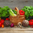Fresh vegetables and herbs on wooden background — Stock Photo #37003397