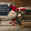 Vintage christmas decoration with antique toys and red candle — Stock Photo