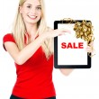 Woman with tablet PC and gift ribbon bow decoration — Stock Photo