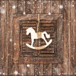 Christmas decoration rocking horse on wooden — Stock Photo #37005795