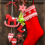 Christmas stocking and handmade toys hanging — Stock Photo #37006065