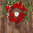 Christmas decoration with wreath from red berries — Stock Photo