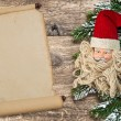 Santa Claus christmas decoration with vintage scroll paper — Stock Photo