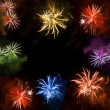 Beautiful colorful fireworks exploding over a dark night sky — Stock Photo #37008603