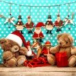 Christmas decorations with antique toys and teddy bear — Stock Photo