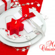 Christmas table place setting decoration in red and silver — Stock Photo #37008751
