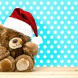 Stock Photo: Charming vintage teddy bear with santa hat