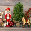 Stock Photo: Christmas decoration with toys teddy bear and nutcracker
