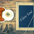 Stock Photo: Coffee with croissant, blackboard and heart decoration