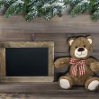 Christmas decoration with teddy bear and blackboard — Stock Photo