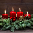Advent decoration with four red burning candles — Stock Photo