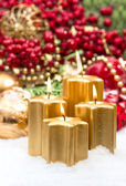 Advent decoration in gold and red with four burning candles — Stock Photo
