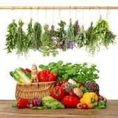 Fresh vegetables and herbs.shopping basket. kitchen interior — Stock Photo