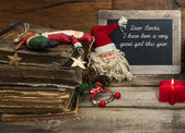 Vintage christmas decoration with antique toys and red candle — Foto de Stock
