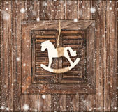 Christmas decoration rocking horse on wooden — Stock Photo