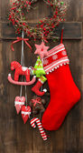 Christmas stocking and handmade toys hanging — Stock Photo