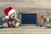Antique toys teddy bear and wooden rocking horse — Foto de Stock