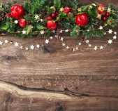 Christmas decorations garland with red apple and green pine — Stock Photo