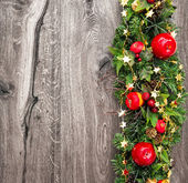 Christmas decoration red green over wooden background — Stockfoto