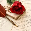 Old letters, rose flower and antique feather pen — Stock Photo