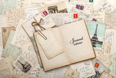 Open empty diary book, old letters, french postcards — Stock Photo