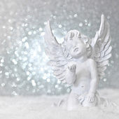 Little white guardian angel in snow — Stock Photo