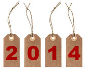 Brown paper tag with string. New Year 2014 — Stock Photo