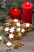 Cinnamon cookies, nuts and spieces with christmas decoration — Stock Photo