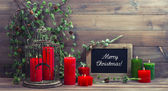 Vintage christmas decoration birdcage and red candles — Stock Photo