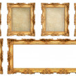 Golden frame with different empty cracked canvas — Stock Photo