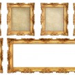 Golden frame with different empty cracked canvas — Stock Photo #40802613