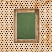 Antyczne zielona tablica na tle starodawny polka dot — Zdjęcie stockowe