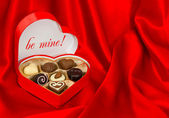 Chocolate pralines in heart shape box. valentine gift — Stock Photo