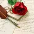 Old letters, rose flower and antique feather pen — Stock Photo #41304815