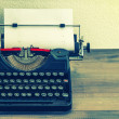 Stock Photo: Retro typewriter with white paper page.