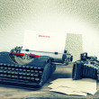 Stock Photo: Typewriter and vintage photo camera. Memories concept