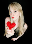 Funny girl with red valentine's heart — Stock Photo