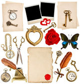 Antique clock, key, photo frame, feather pen, butterfly — Stock Photo