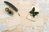 Old letters, vintage postcards and antique pen — Stock Photo