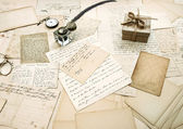 Old letters, vintage postcards and antique feather pen — Stock Photo