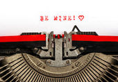 Old typewriter with sample text BE MINE — Stock Photo