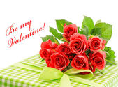 Fresh red roses with gift — Stock Photo