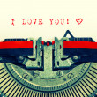 Stock Photo: Typewriter with sample text I LOVE YOU and heart