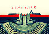 Typewriter with sample text I LOVE YOU and heart — Stok fotoğraf